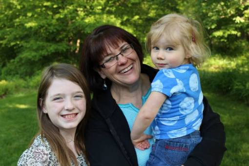 Me, with Abby (Sara's) and holding Kate (Molly's), June 2013. Photo credit: Mike Beck